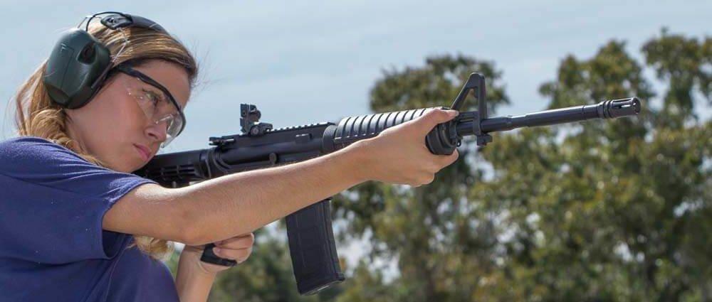 Woman firing a gun