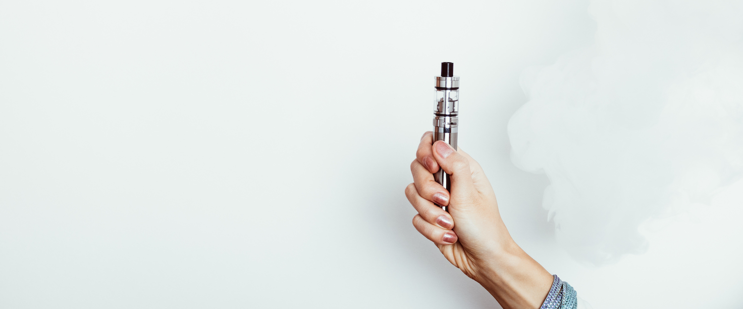 Woman holding a vape pen