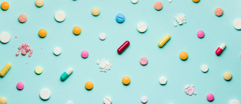 crushed pills on blue background